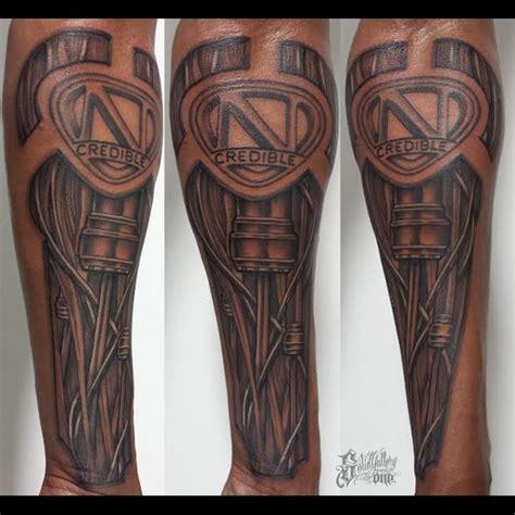 cannon tattoo nick cannon s biomechcanical sleeve artist jarrett
