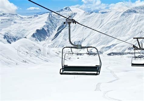 ski lift chairs on bright winter day stock photo colourbox