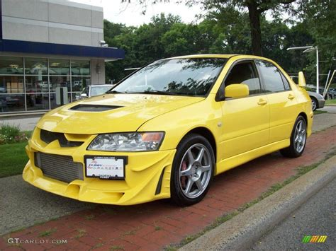 mitsubishi yellow yellow mitsubishi lancer evo car photos pictures
