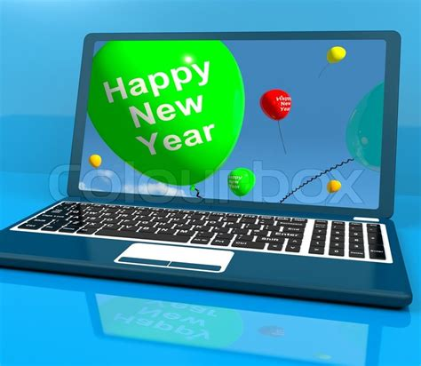 laptop computer with happy new year message stock photo