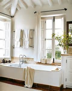 By my last post i found this picture of this rustic white bathroom