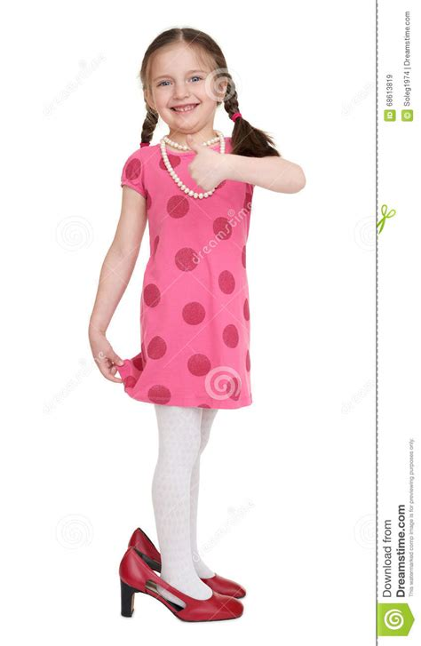 child high heels child in dress and shoes with high heels stock