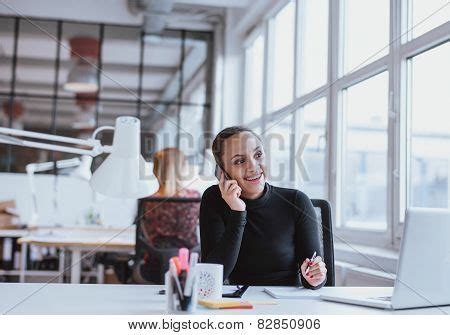 crating a while at work using mobile phone while at work stock photo stock images bigstock