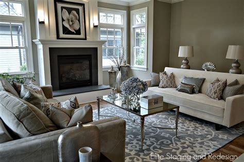 modern living room with cement fireplace by elite staging