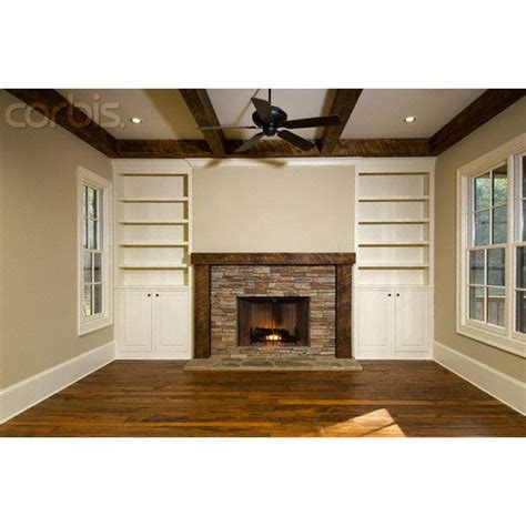 dad built this living room shelf empty living room with brick fireplace and built in