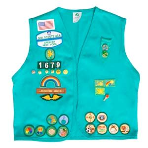 junior sash and vest tonight we had our girl scout final ceromony i got tons
