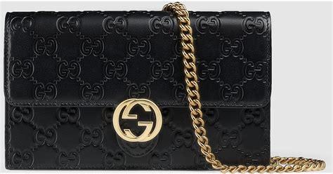 Gucci Broche Gg Sling Bag Ac865 gucci icon signature chain wallet in black lyst