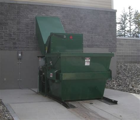 what is a trash compactor container friendly thru the wall compactors