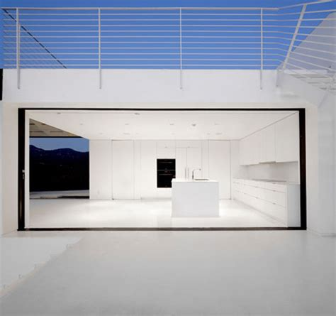 minimalist house with glass design by xten architecture