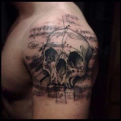 music themed tattoos themed black ink shoulder of human skull with
