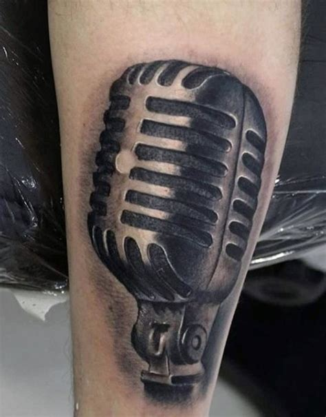 microphone tattoo arm simple designed black ink vintage microphone tattoo on arm