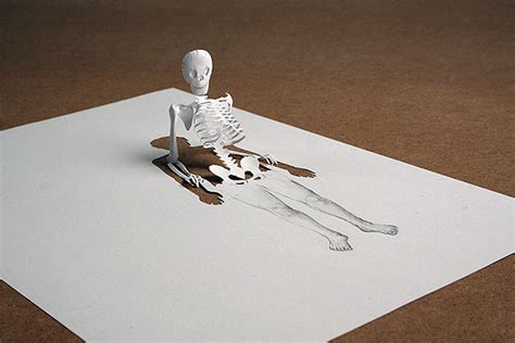 How To Make A Paper Sculpture - skeletons and saints emerge from single pieces of paper in