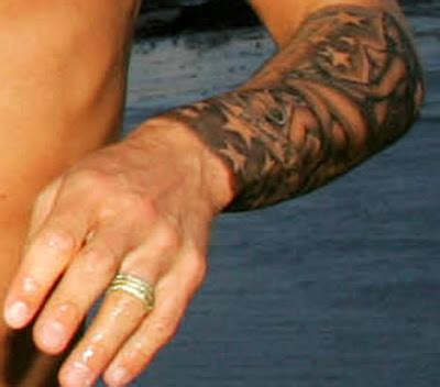 new tattoo raised up booby s ink beckham s new tattoo posh in the nude