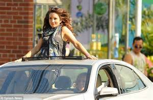 Camouflage Bedroom Set tina fey stands up in a car driven by amy poehler on set