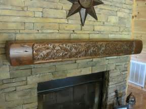 rustic fireplace mantel with carved oak leaves