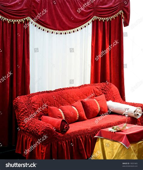 big red sofa old style interior with big red sofa and curtains stock