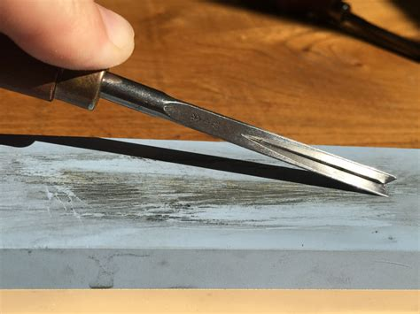 sharping tools sharpening lino cutting tools using a whetstone