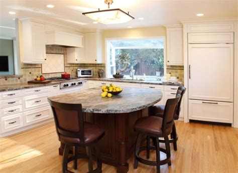 kitchen island with stove and seating dining table and chairs kitchen range hoods kitchen