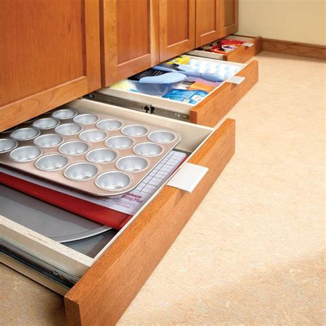 kitchen drawer organizer gives you extra storage home toe kick drawer home remodel pinterest