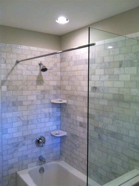 Shower Curtains For Glass Showers This Tub Shower Benefits From A Glass Splash Panel As Well As The Rod For The Shower Curtain