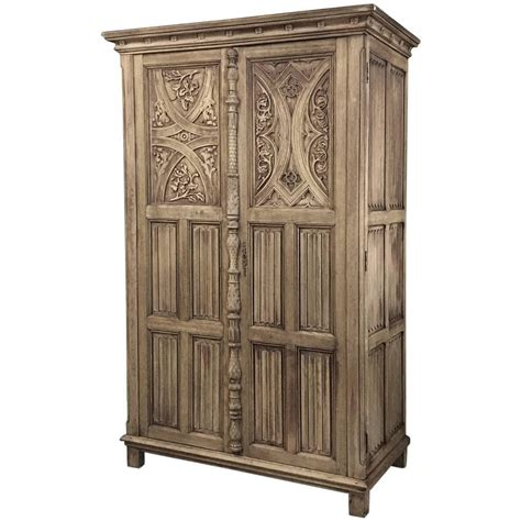 antique stripped gothic hand carved solid oak armoire at