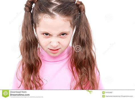 angry little girl in pink isolated on a white background portrait of a small emotional girl stock photo image