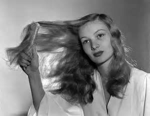 Constance keane brushes her lustrous honey blond hair undated photo