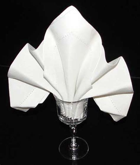 Folding Paper Napkins In Glasses - dinner napkin origami