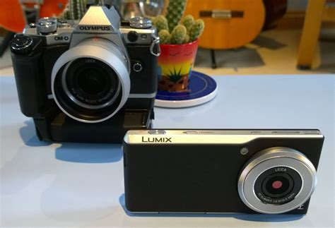 Hp Panasonic Lumix Dmc Cm1 how does the panasonic lumix dmc cm1 compare to the olympus om d e m5 ii is this a
