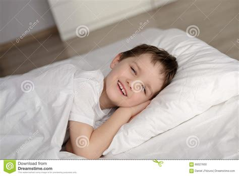 bed eyes little boy waking up in white bed with eyes open stock photo image 66027600