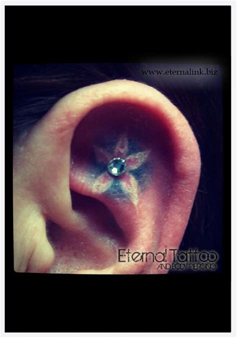 flower tattoo in ear with piercing 10 best images about body piercings on pinterest mind