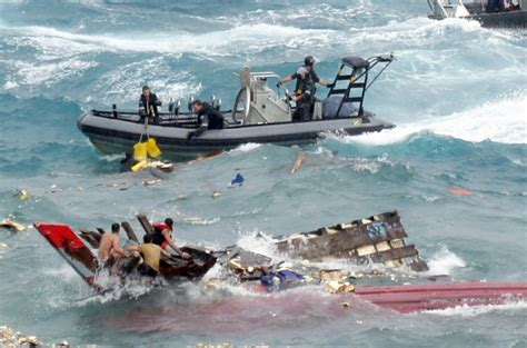 refugee boat australia dozens die after refugee boat sinks off christmas island