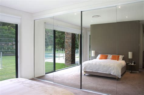 Mirrored Sliding Closet Doors For Bedrooms by Semi Frameless Mirror Doors Bedroom Wardrobe Concealed