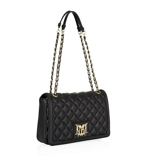 Moschino Bag moschino medium quilted flap bag in black lyst