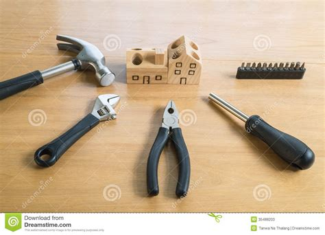 Handcrafted Tools - set of tools and handmade wood house stock image