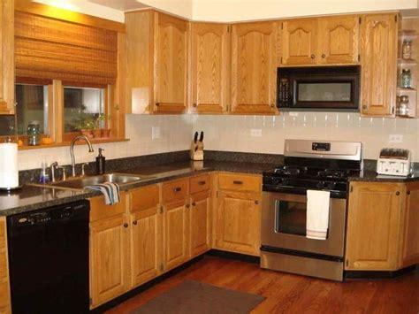 black stainless steel appliances  oak cabinets oak