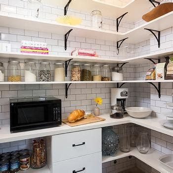 stacked wood kitchen shelves with iron brackets walk in pantry design ideas