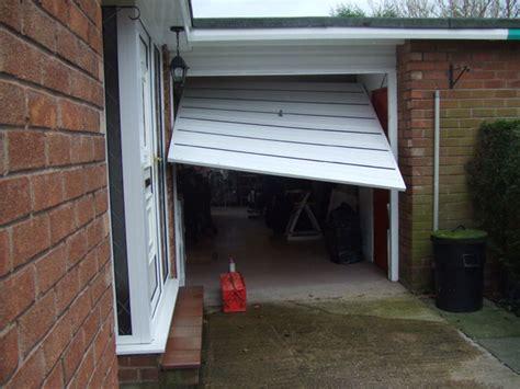 Broken Garage Door by Express Garage Doors Cardiff Newport Bridgend South