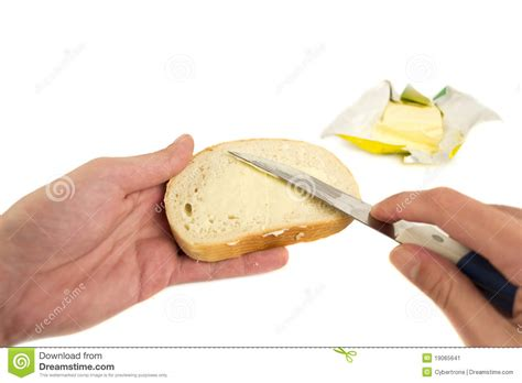 Buttered Bread In Toaster Hand Spreading Butter On Slice Of Bread Stock Image