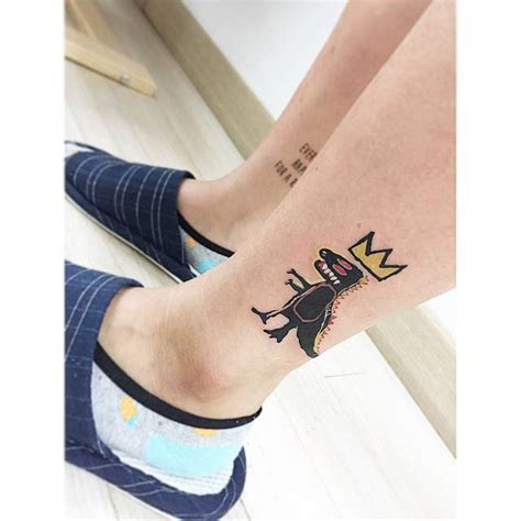 jean michel basquiat s iconic t rex tattoo
