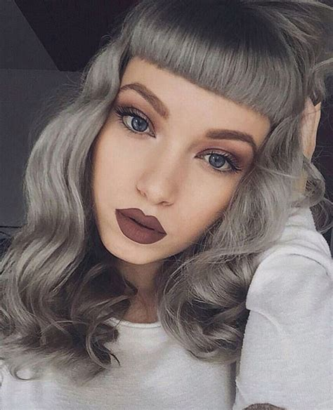bangs and gray hair bold heavy straight bangs metallic silver grey hair