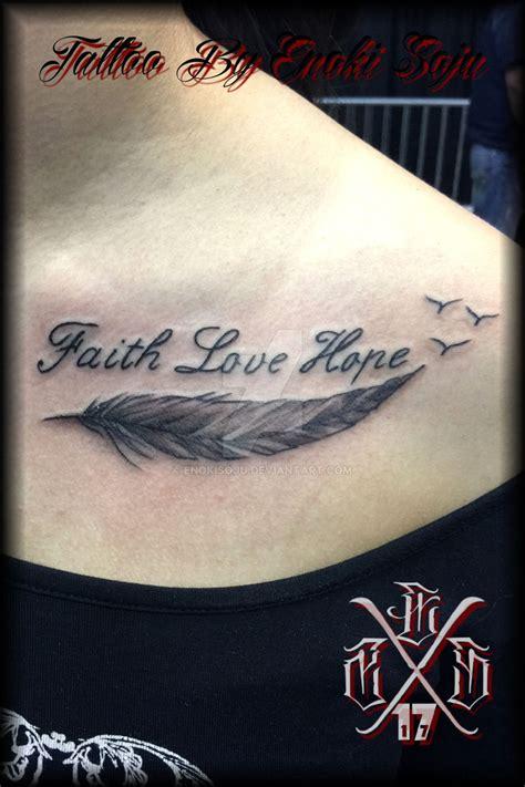 feather tattoo meaning faith faith love hope feather tattoo by enoki soju by enokisoju