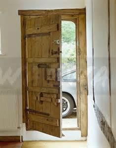 Rustic Wood Front Doors Image Open Rustic Wooden Front Door In White Cottage Ewa Stock Photo Library