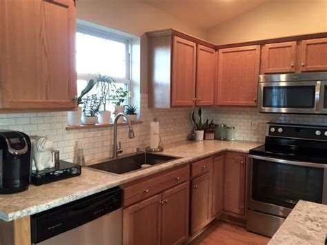 Laminate Countertops With Oak Cabinets by The Feel Of A White Kitchen Without White Cabinets