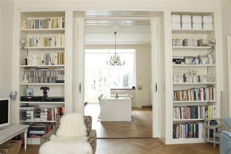 Bookcase With Rolling Ladder Floor To Ceiling Bookshelves Living Room Transitional With