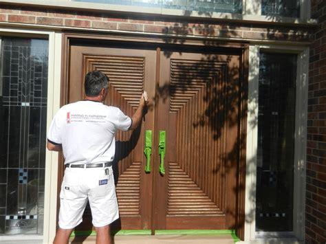 refinishing exterior solid wood door painting brown color metal handle green color narrow fiberglass window ideas