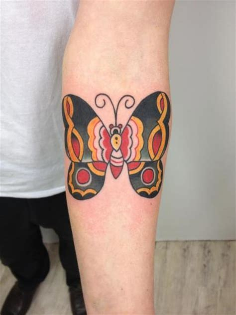 arm old butterfly tattoo by three kings tattoo