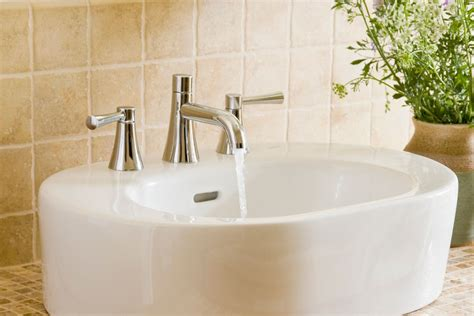 installing bathroom faucet how to install a two handle aquasource bathroom faucet