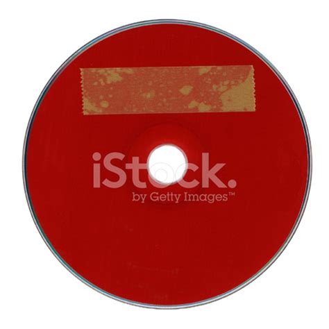 red cd dvd disc with yellow label stock photos