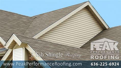 roof peak shingles trimmed back from ridge vent holes